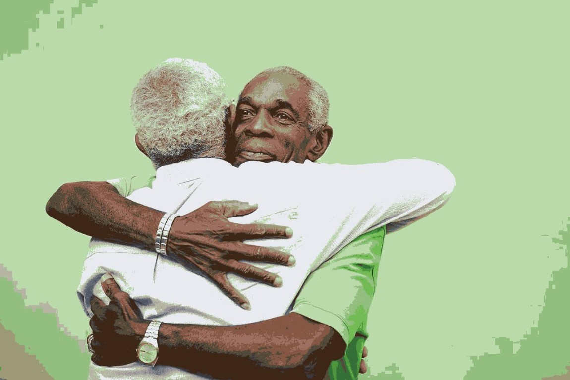 Old friends, two senior african american men meeting and hugging ...